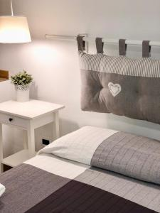 A bed or beds in a room at I Rolli a Genova