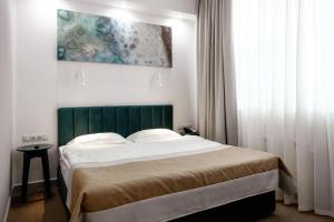 A bed or beds in a room at Boutique Hotel Khabarovsk City