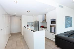 A kitchen or kitchenette at 4 Bedroom Executive Apartment in the CBD