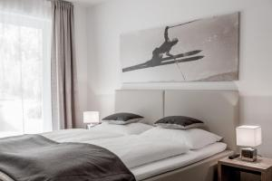 A bed or beds in a room at Soelden Lounge