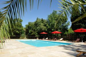 The swimming pool at or near Chambres d'Hotes Domaine des Machottes