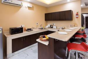 A kitchen or kitchenette at Reunion In Delhi-Spacious Lounge with 2 large BR