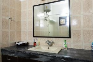 A bathroom at Reunion In Delhi-Spacious Lounge with 2 large BR
