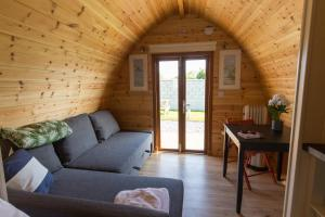 A seating area at Blackwater Eco Pods