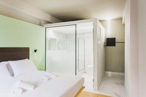 A bed or beds in a room at Greece U Around Athens Thissio Suites
