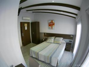 A bed or beds in a room at Hotel Fontanella