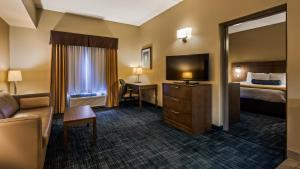 A television and/or entertainment center at Best Western Plus Winnipeg West