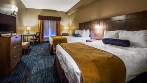 A bed or beds in a room at Best Western Plus Winnipeg West