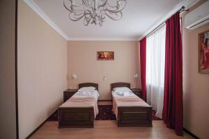 Кровать или кровати в номере Hotel RUM