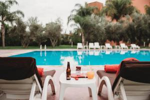 The swimming pool at or near Ibis Marrakech Palmeraie