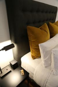 A bed or beds in a room at @ VDL Stanley