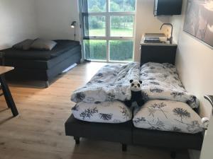 En eller flere senge i et værelse på Egtved B&B