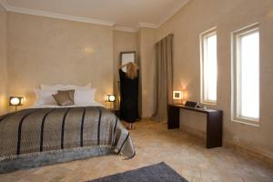 A bed or beds in a room at Riad Cocoon