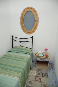 Letto o letti in una camera di Baglio Locoforte