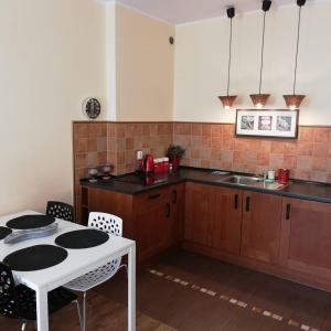 A kitchen or kitchenette at Quiet-Apartments Centrum II