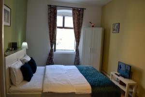 מיטה או מיטות בחדר ב-Casa Krone - Piața Sfatului