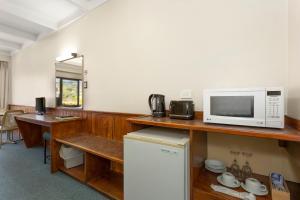 A kitchen or kitchenette at Village Family Motor Inn
