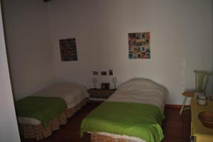A bed or beds in a room at Casa típica alentejana