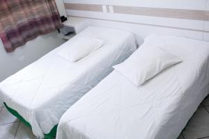 Cama ou camas em um quarto em Hotel Passarela