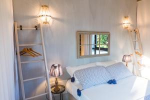 Letto o letti in una camera di Villa Colli Storici