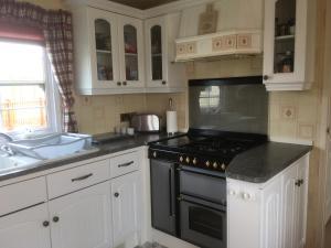 A kitchen or kitchenette at Golden palm resort skegness
