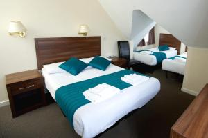 A bed or beds in a room at King Solomon Hotel- Golders Green