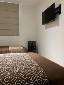 Cama o camas de una habitación en Cantabria House Suites