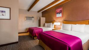 A bed or beds in a room at Best Western Canyon De Chelly Inn