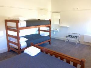 A bunk bed or bunk beds in a room at Great Ocean Road Brewhouse