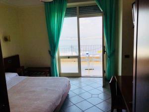 Кровать или кровати в номере Hotel Elisabetta
