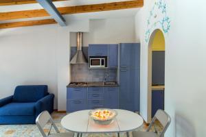 Cuisine ou kitchenette dans l'établissement Medea Residence