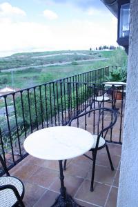 Un balcón o terraza de Hostal La Balquina