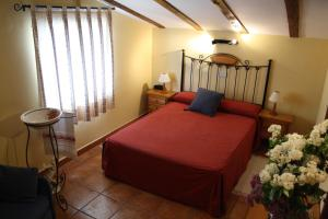 Cama o camas de una habitación en Hostal La Balquina