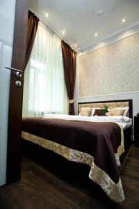 Кровать или кровати в номере Бутик Отель Ленинград