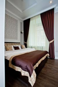 A bed or beds in a room at Boutique Hotel Leningrad