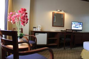 Una televisión o centro de entretenimiento en Summit Hotel KL City Centre