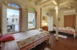 A bed or beds in a room at French Haveli