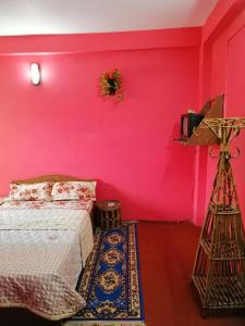 A bed or beds in a room at Anmol Guest House