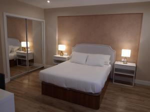Cama o camas de una habitación en H.Albar Mieres