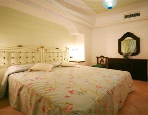 A bed or beds in a room at Tenuta Villa Tara