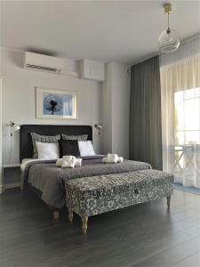 Posteľ alebo postele v izbe v ubytovaní Apartamenty Retmana