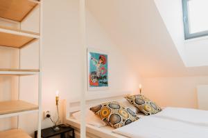 Кровать или кровати в номере Street Food Possonium Apartments