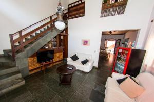 A seating area at Social Ilha Grande Hostel