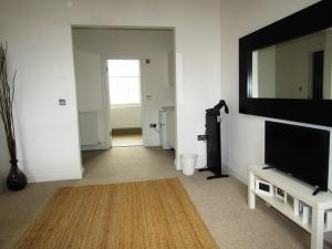 A television and/or entertainment center at Large Modern Private Room in King Cross (5)
