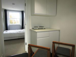 A kitchen or kitchenette at King Cross Private Double room (6)