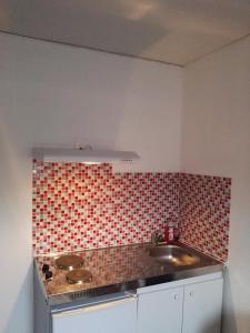 Cuisine ou kitchenette dans l'établissement Résidence Le 23 Amiens Centre