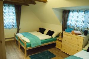 Postel nebo postele na pokoji v ubytování Apartmany Silverado