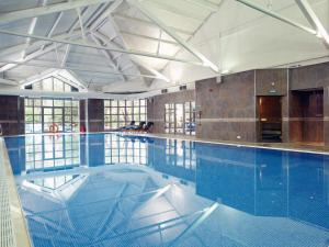 The swimming pool at or near Macdonald Frimley Hall Hotel & Spa