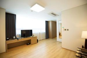 A television and/or entertainment center at Best Western Haeundae Hotel