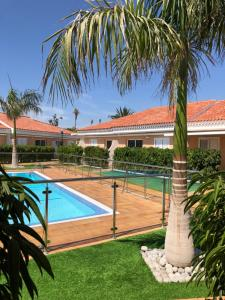 The swimming pool at or near Los Leones Bungalows